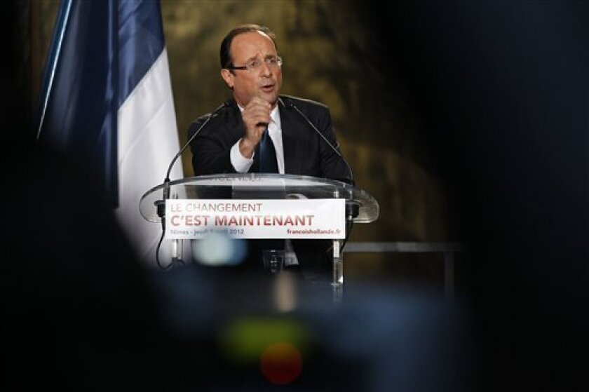 French Socialist Party candidate for the 2012 presidential elections Francois Hollande delivers a speech during a meeting in Nimes, southern France, Thursday, April 5, 2012. (AP Photo/Laurent Cipriani)