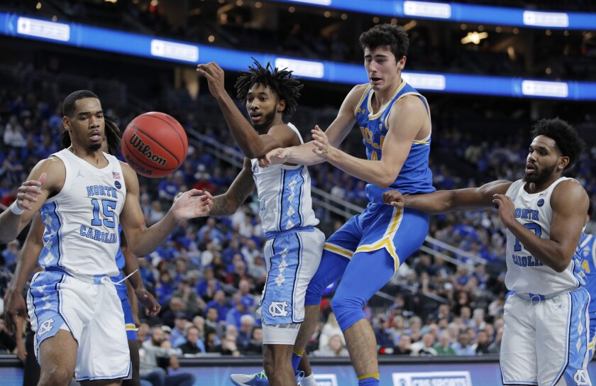 UCLA's Jaime Jaquez Jr. battles a bevy of North Carolina players for the ball during the Bruins' loss Dec. 21, 2019.