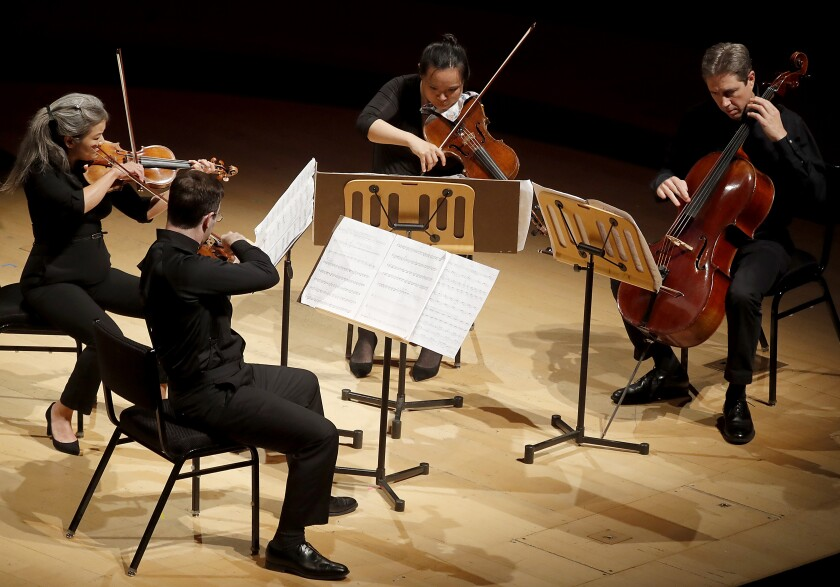 """The string quartet performs """"Carrot Revolution"""" by Gabriella Smith in Disney Hall on Tuesday."""
