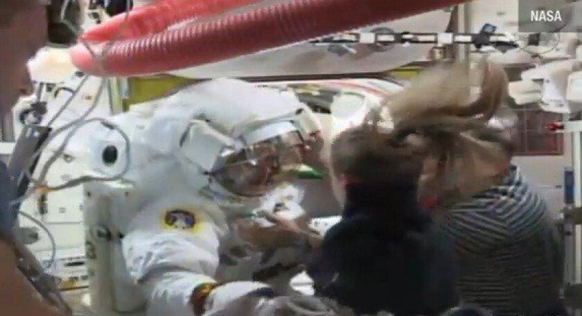 European Space Agency astronaut Luca Parmitano is helped out of his spac suit after a water leak in his helmet caused officials to abort a spacewalk outside the International Space Station.