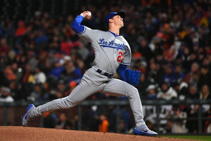 Dodgers pitcher Walker Buehler throws a pitch in the first inning against the Giants on Friday in San Francisco.