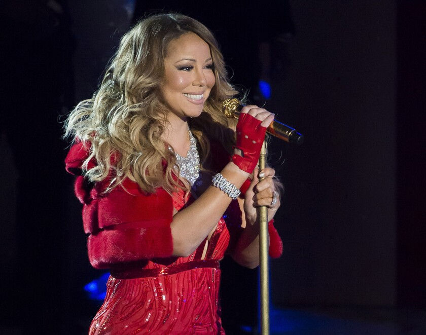 Mariah Carey poses at the microphone