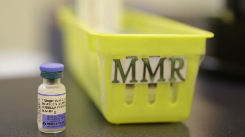 FILE - This Feb. 6, 2015, file photo, shows a measles, mumps and rubella vaccine on a countertop at