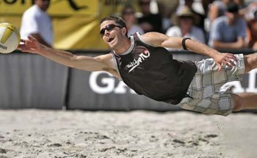Jeff Nygaard, who with John Mayer were upset winners of the AVP Crocs Tour stop at Harrah's Rincon Casino, dives for the ball.   (Sean M. Haffey / Union-Tribune)
