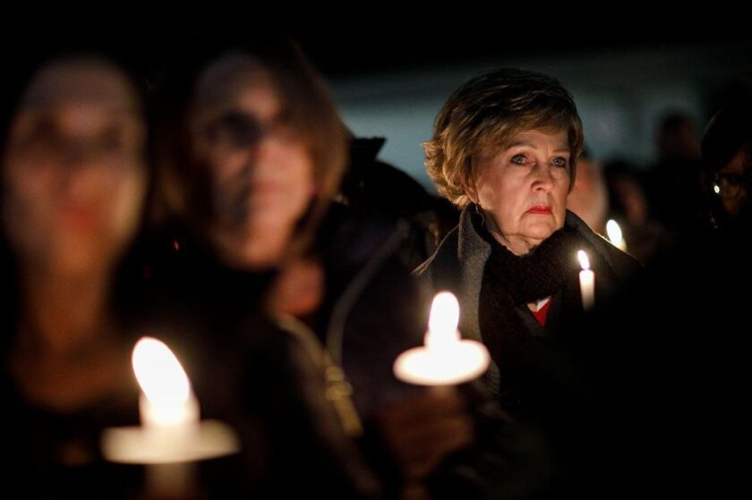 Community members at Thursday's vigil for the four people killed Sunday when pieces of a plane plunged into their Yorba Linda home.