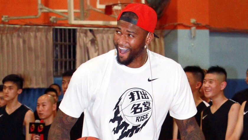 Sacramento Kings center DeMarcus Cousins laughs while hosting a basketball camp in Taipei, Taiwan, on June 8.
