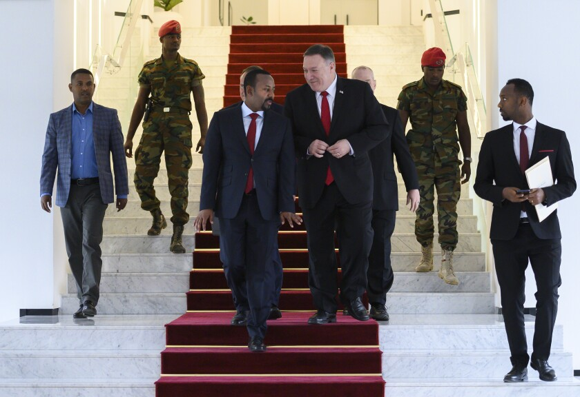 "FILE - In this Tuesday, Feb. 18, 2020 file photo, U.S. Secretary of State Mike Pompeo, center right, walks with Ethiopia's Prime Minister Abiy Ahmed, center-left, after meeting at the Prime Minister's office in Addis Ababa. The State Department said Wednesday, Sept. 2, 2020 that on the guidance of President Donald Trump the U.S. is suspending some aid to Ethiopia over the ""lack of progress"" in talks with Egypt and Sudan over a massive, disputed dam project which Egypt has called an existential threat and worries will reduce the country's share of Nile waters. (Andrew Caballero-Reynolds/Pool via AP, File)"