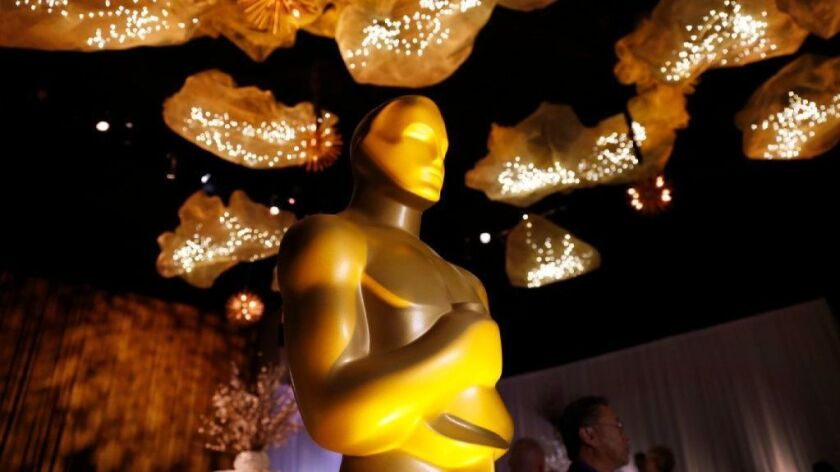 Oscar statue under the ceiling artwork that is featured through the Ray Dolby Ballroom for the 89th Oscars Governors Ball.