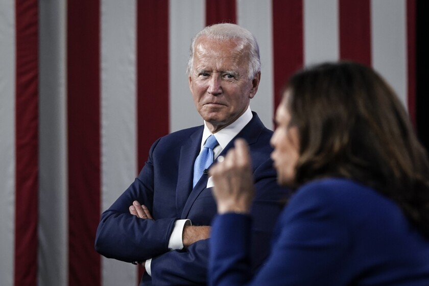 Joe Biden listens as his running mate, Sen. Kamala Harris (D-Calif.), speaks during a virtual fundraising event.