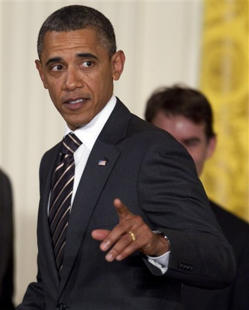 President Barack Obama gestures during an event in the East Room of the White House to honor NASCAR driver Jimmie Johnson for his fifth consecutive championship on Wednesday, Sept. 7, 2011, in Washington. (AP Photo/Evan Vucci)