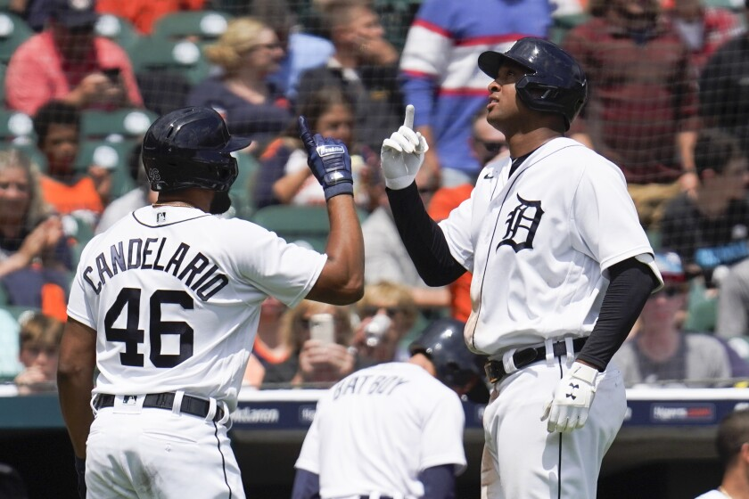 Detroit Tigers' Jonathan Schoop, right, celebrates his solo home run with Jeimer Candelario (46) in the fifth inning of a baseball game against the St. Louis Cardinals in Detroit, Wednesday, June 23, 2021. (AP Photo/Paul Sancya)