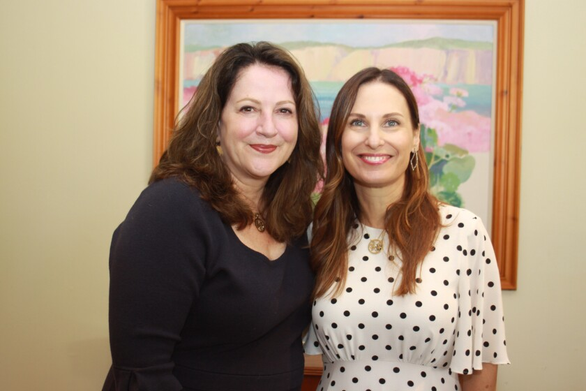 Outgoing Las Patronas president Michelle Wiseman and outgoing Jewel Ball chair Nicole Velazquez