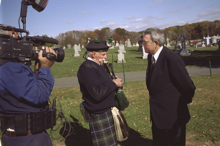 (Center) James Ginty, a founding member of the FDNY Emerald Society Pipes and Drums is interviewed by CBS-TV's Dan Rather (right) for a 60 Minutes II feature piece in 2001. Ginty has passed away at the age of 84.