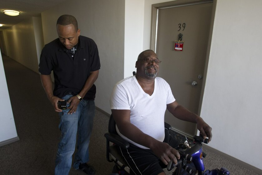 Michael Lacey of San Diego, left. is a caregiver for his uncle John Lucas and would be paid for fewer hours of service if state budget cuts take effect.