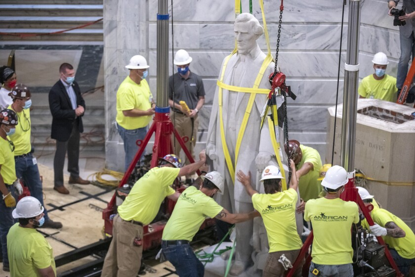 Workers prepare to remove the Jefferson Davis statue from the Kentucky state Capitol in Frankfort, Ky., on Saturday.