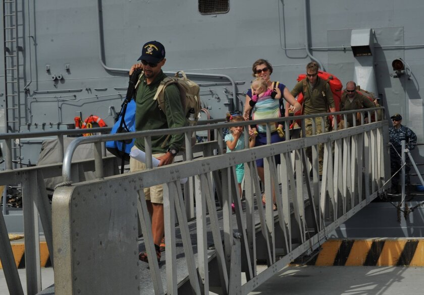 The Kaufman family disembarks the Oliver Hazard Perry-class guided missile frigate USS Vandegrift (FFG 48) following their rescue at sea April 6. The rescue was a joint effort involving Navy, Coast Guard and California Air National Guard personnel.