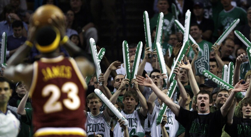 FILE - In this May 7, 2010, file photo, Boston Celtics fans try to distract Cleveland Cavaliers forward LeBron James (23) while he shoots foul shots during the first quarter of Game 3 in the second round of an NBA basketball playoff series in Boston. When the virus wanes enough to allow the games to begin again, the very essence of these events will likely be missing. Playing in empty buildings would require a significant recalibration. (AP Photo/Charles Krupa, File)