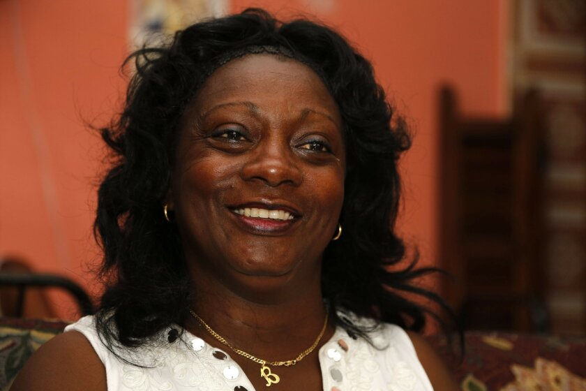 """In this July 6, 2015 photo, the leader of a faction of the Ladies in White, Berta Soler, speaks during an interview in the dissident group's headquarters, in Havana, Cuba. """"The only thing they want is to open up business, the embassy,"""" said Soler. """"Whenever someone high-level came from the United States before, they always had time to meet with us before getting on the plane (back home), and that's not happening."""" (AP Photo/Desmond Boylan)"""