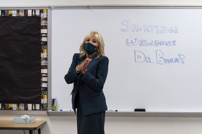 "FILE - In this Sept. 1, 2020, file photo Jill Biden, wife of Democratic presidential candidate former Vice President Joe Biden, walks past a dry erase board in a classroom that reads ""Shortlidge Welcomes Dr. Biden,"" as she tours the Evan G. Shortlidge Academy in Wilmington, Del. In an election year where reopening schools shuttered by the coronavirus pandemic is emerging as a flashpoint, Jill Biden is increasingly drawing on her experience in the classroom to empathize with parents struggling to cope with the shift to virtual learning. (AP Photo/Carolyn Kaster, File)"