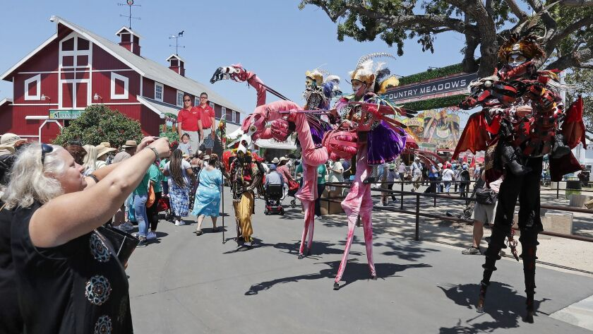 Dragon Knights greet visitors on opening day of the 2019 Orange County Fair.