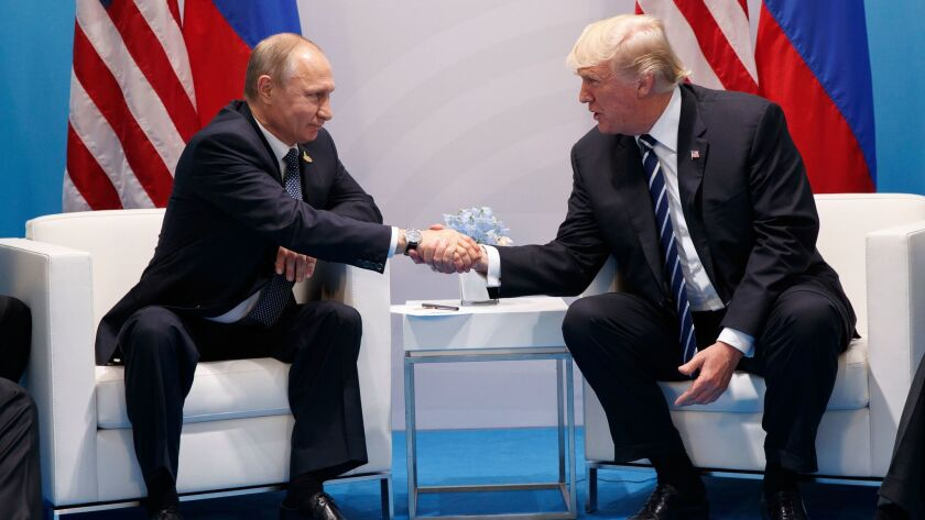 President Donald Trump shakes hands with Russian President Vladimir Putin at the G20 Summit on July 7 in Hamburg, Germany.