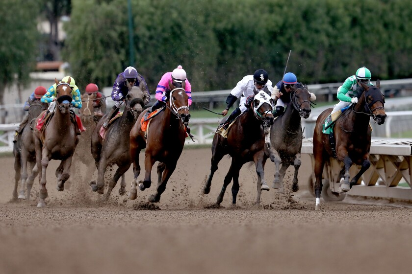 The horses hit the home stretch in the day's second race at Santa Anita Park in Arcadia, Calif., on March 14, 2020.