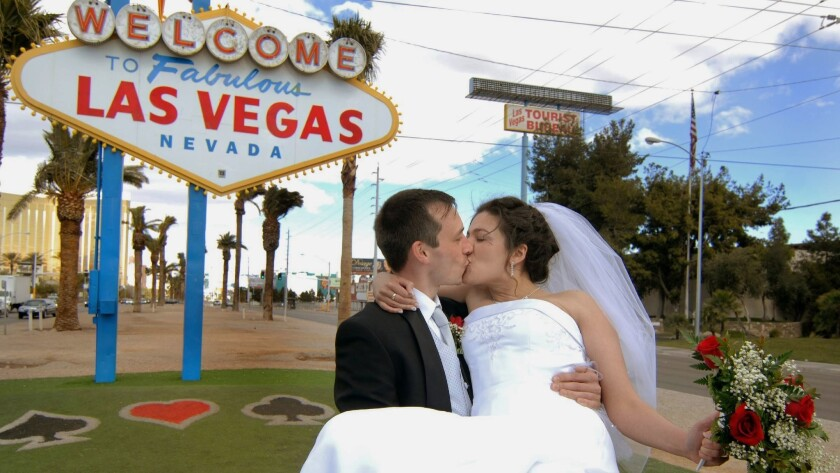In this photo provided by the Las Vegas News Bureau, Newlyweds Anton and Alina Deschner, from Lieder