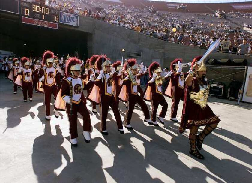 USC's Trojan marching band enter the Coliseum from the players tunnel.