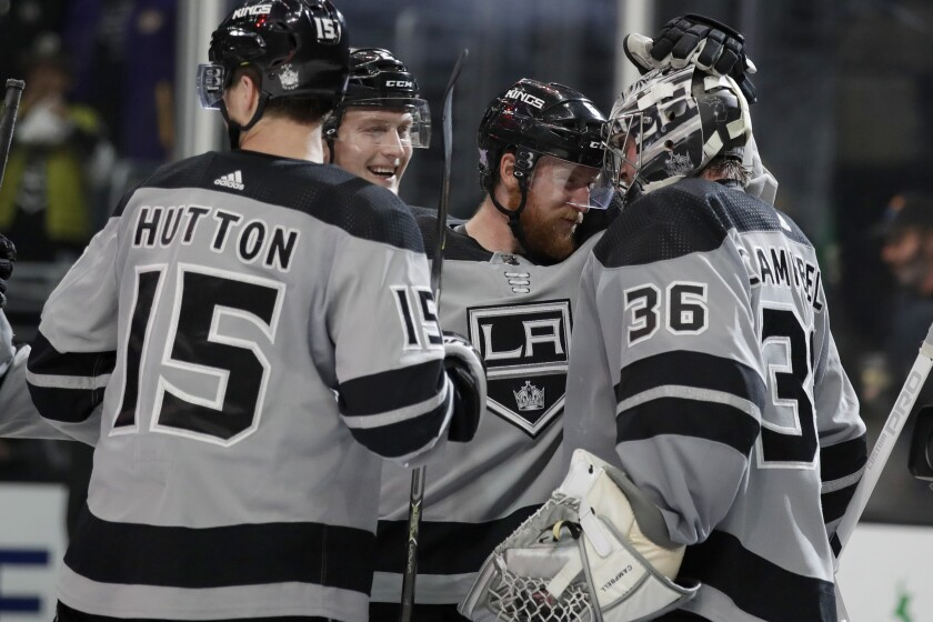 The Kings celebrate a 2-1 win over the Winnipeg Jets on Saturday at Staples Center.