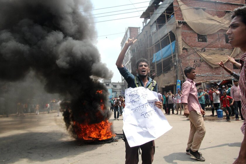 Demonstrators set fire to bicycle tires as they protest the slaying of law school student and online activist Nazimuddin Samad in Dhaka, Bangladesh, on April 7, 2016.