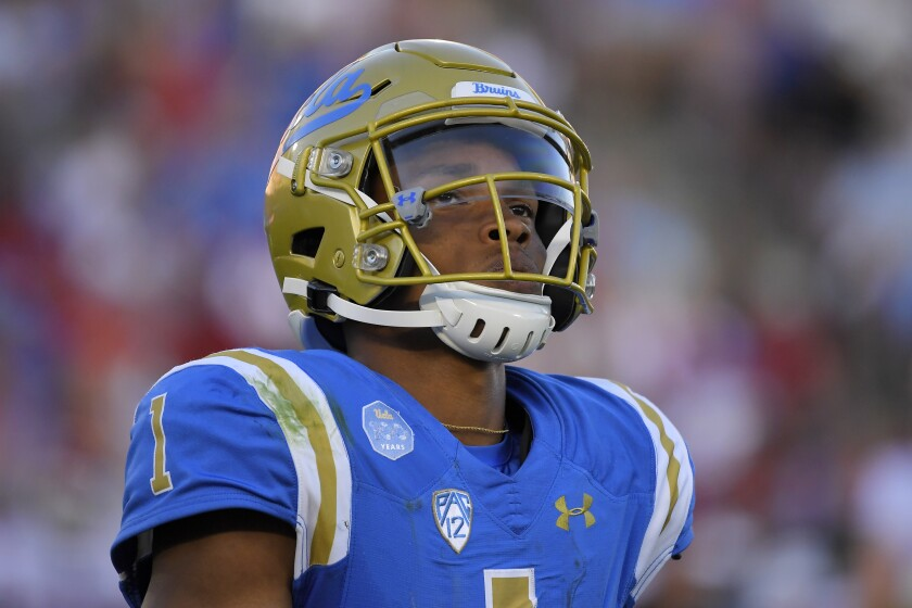 UCLA quarterback Dorian Thompson-Robinson stands on the field during Saturday's loss to Oklahoma.
