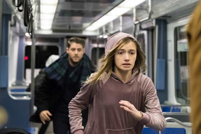"""Jon Abrahams and Nicole Elizabeth Berger running in a train car in """"Clover."""""""