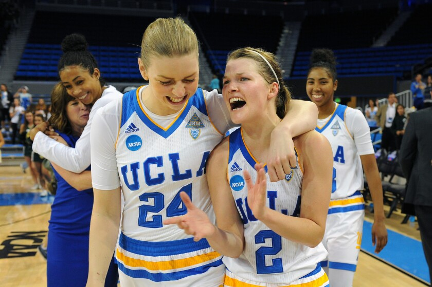 UCLA's Paulina Hersler (24) and Kari Korver (2) celebrate after beating South Florida 72-67 to advance to the Sweet 16.