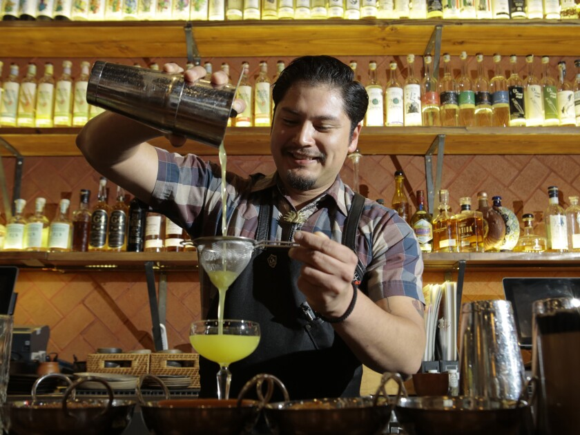 Bartender Bryant Orozco mixed up cocktails in a pre-COVID Madre restaurant.