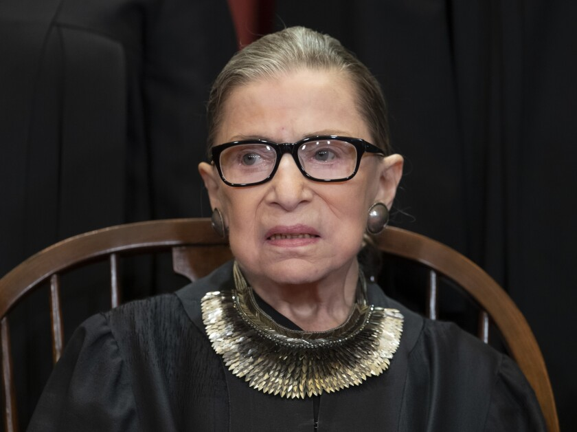 Supreme Court Associate Justice Ruth Bader Ginsburg is pictured in black robes and glasses in 2018