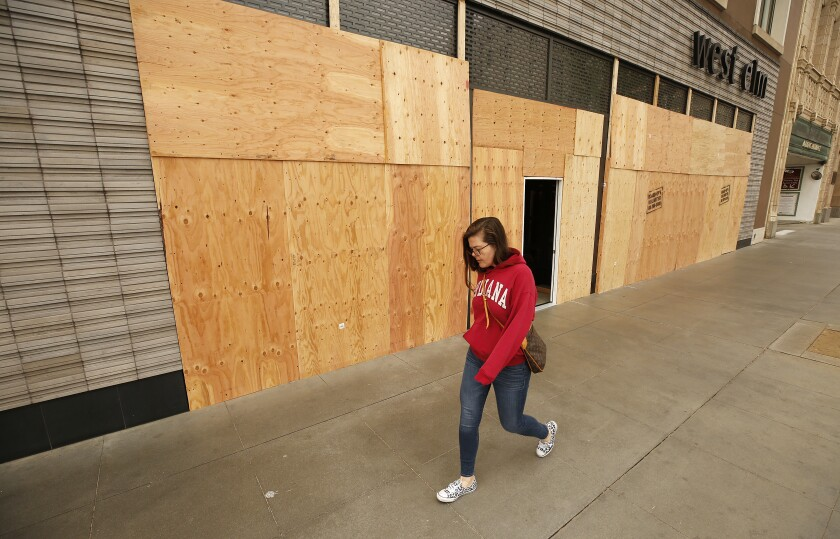 Some retailers in Beverly Hills and Pasadena have boarded up their storefronts during the coronavirus pandemic, possibly to avert vandalism.