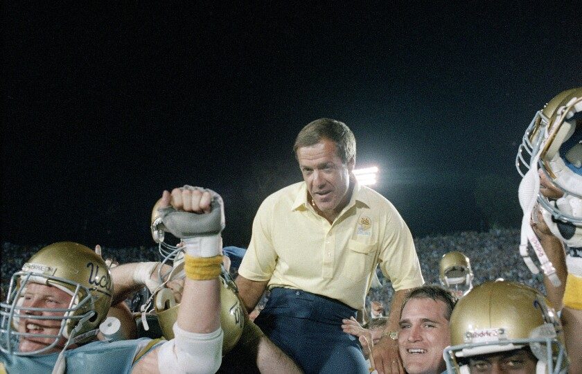 UCLA coach Terry Donahue is carried off the field after the Bruins defeated Nebraska at the Rose Bowl in 1998.