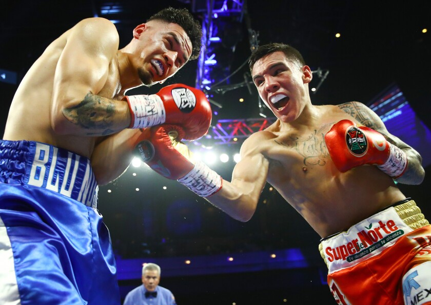 Oscar Valdez, right, punches Adam Lopez during his junior lightweight victory