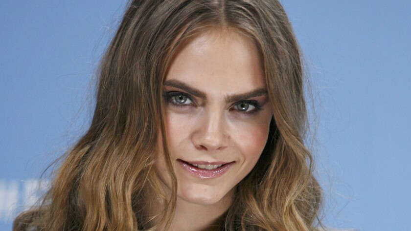 """Cara Delevingne's love life has her feeling """"so happy"""" these days about who she is, she tells Vogue."""