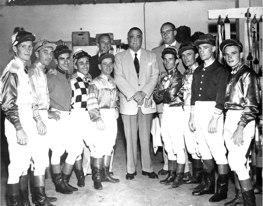 J. Edgar Hoover in jockeys' room with riders and their officials in 1947.