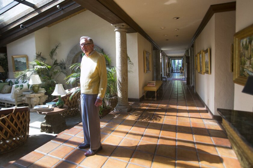 """Neil Ash at home in Rancho Santa Fe. """"There would not be a USO San Diego without Neil Ash,"""" a colleague said."""