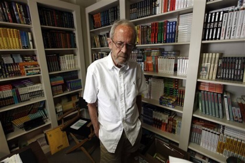 FILE - In this Sept. 17, 2012 file photo, author Elmore Leonard, 86, stands in his Bloomfield Township, Mich., home. Leonard, a former adman who later in life became one of America's foremost crime writers, has died. He was 87. His researcher says he passed away Tuesday morning, Aug. 20, 2013 from