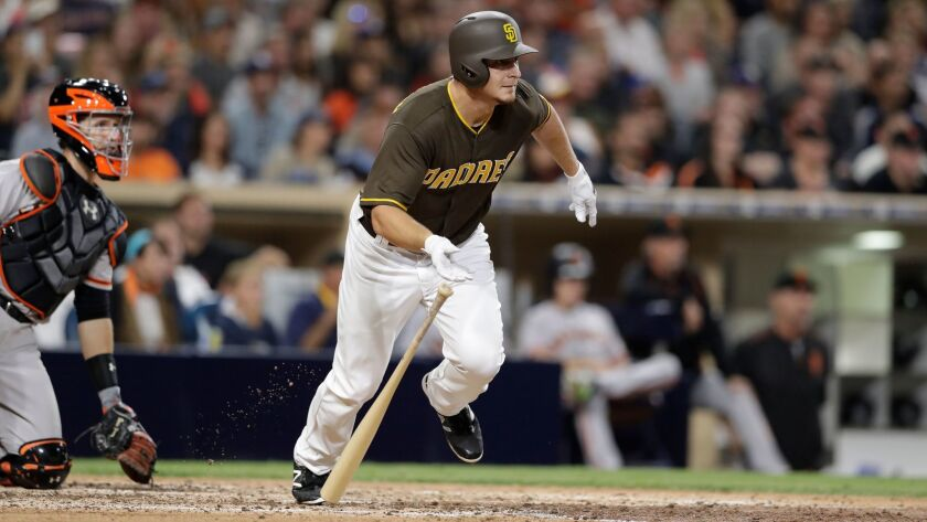 San Diego Padres' Alex Dickerson hits a two-RBI single during the fifth inning of a baseball game ag