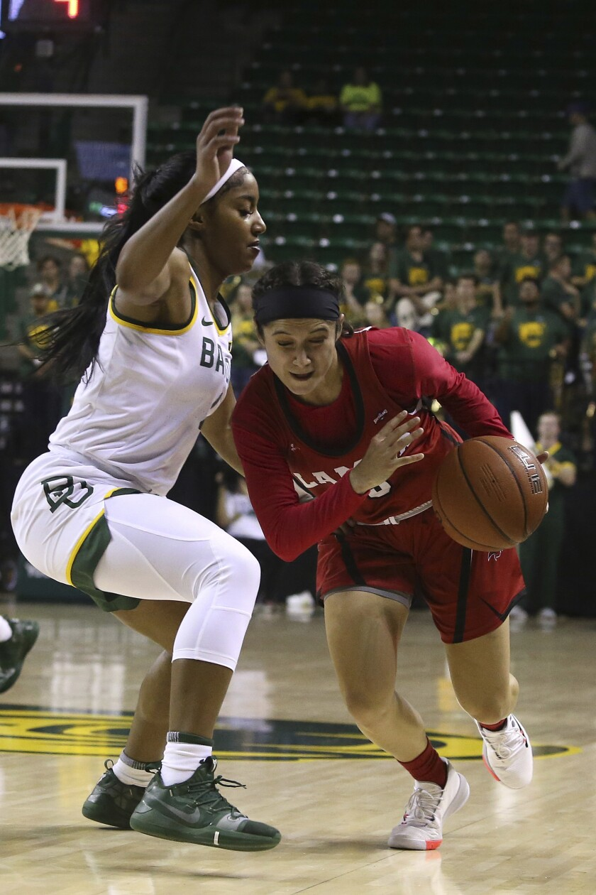 Lamar guard Amber Vidal (5) drives against Baylor Te'a Cooper in the first half of an NCAA college basketball game, Thursday, Nov. 21, 2019, in Waco, Texas. (AP Photo/Jerry Larson)