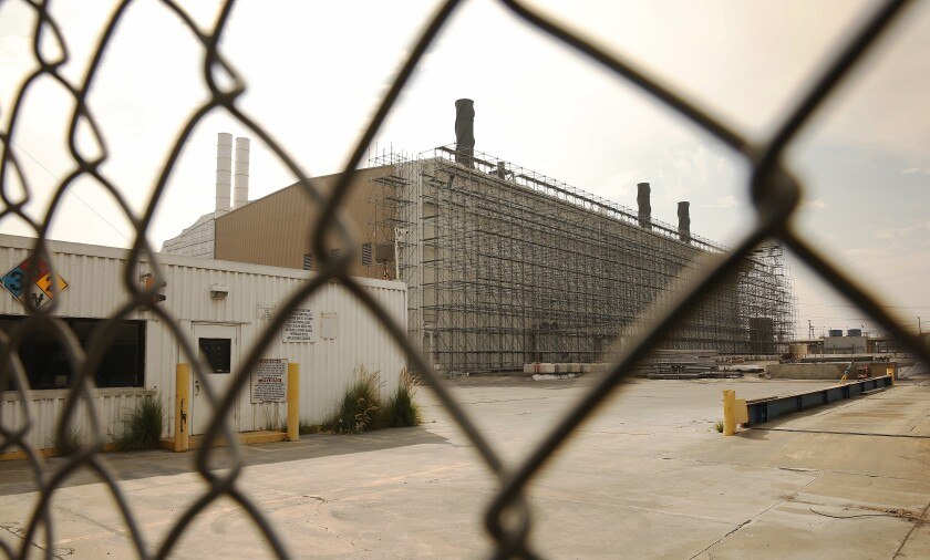 The former Exide battery recycling plant in Vernon, seen through a chain-link fence