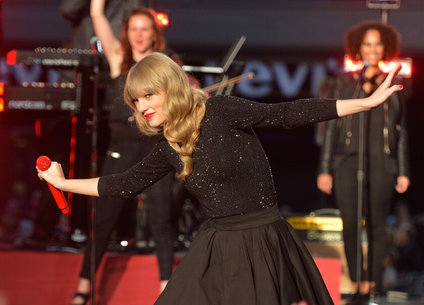 """Taylor Swift, shown during her recent performance on """"Good Morning America,"""" sold 1.21 million copies of her new album """"Red"""" in one week."""