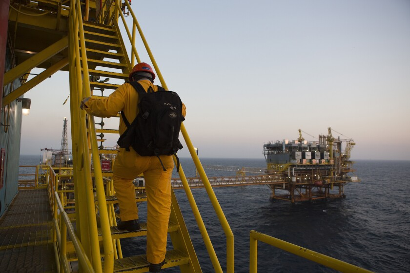 A worker climbs to the heliport at the Petroleos Mexicanos Pol-A Platform complex on the continental shelf in the Gulf of Mexico.