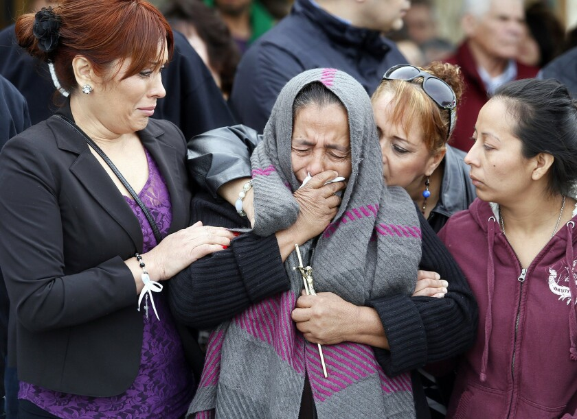 Agapita Montes-Rivera, second from left, the mother of Antonio Zambano-Montes, is comforted following the funeral for her son on Wednesday, Feb. 25, 2015, in Pasco, Wash.