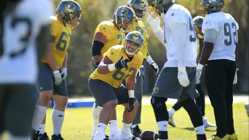 Center Jeremiah Kolone (62), shown practicing with the San Diego Fleet in February, is trying to earn a job with the Los Angeles Rams this summer.