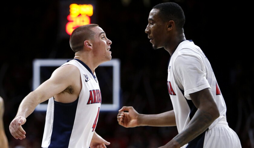 Arizona guard T.J. McConnell, left, and forward Rondae Hollis-Jefferson celebrate during the second half of their rout of Oregon State on Jan. 30.